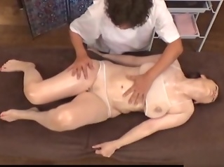 Sultry babe gets her twat fucked during massage big tits